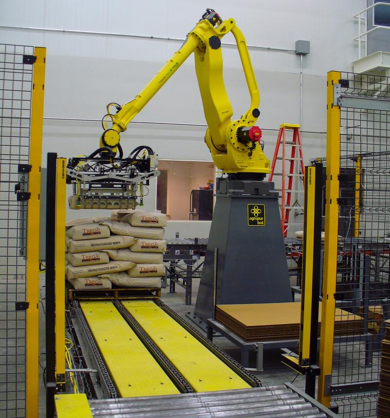 robotic bag palletizer stacking 25 kg bags of dairy powder in Iowa