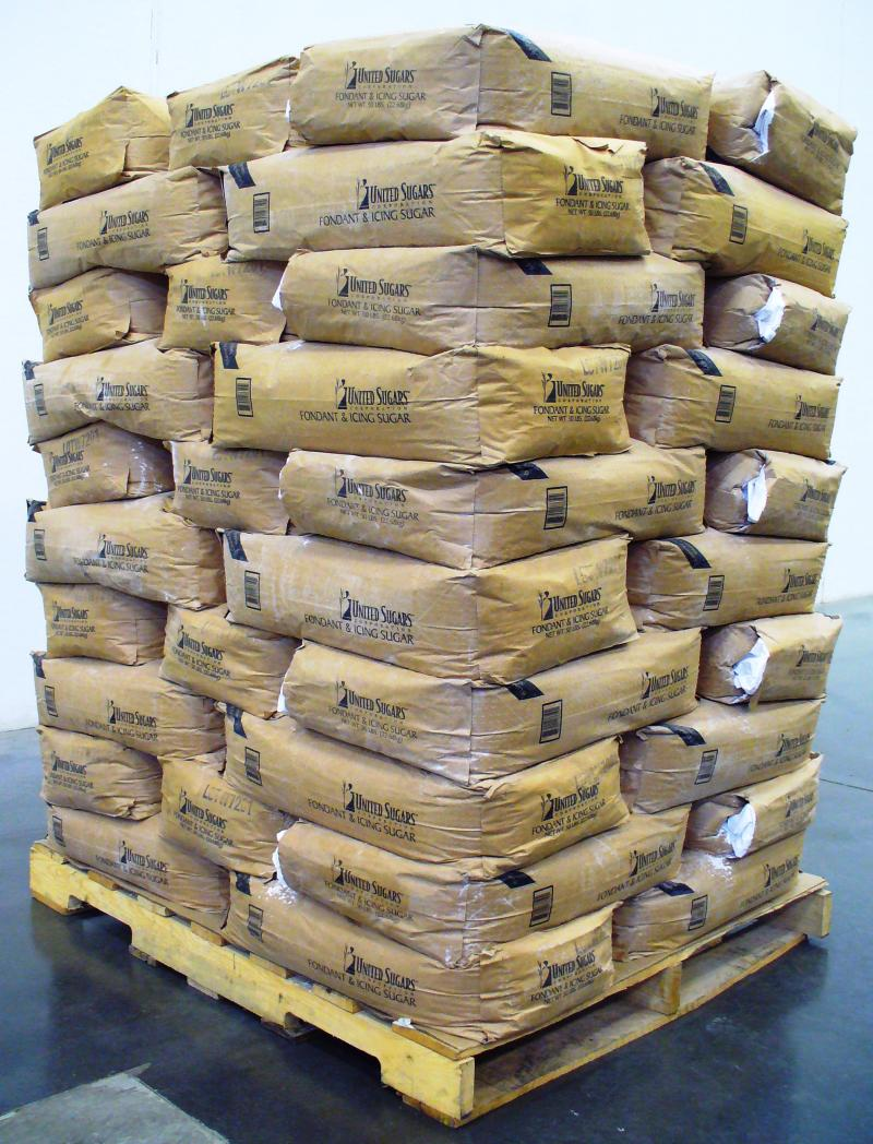 50 pound valve bags of powder sugar stacked by a robotic bag palletizer in ND